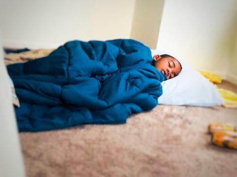 AJ asleep on mat in master bedroom